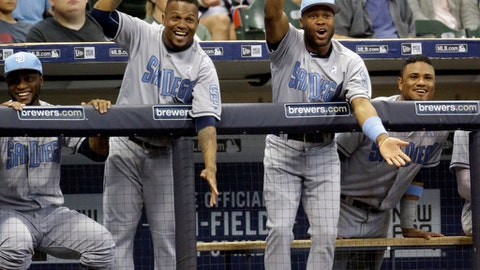 San Diego Padres players cheer after teammate Chase d'Arnaud's home run against the Milwaukee Brewers during the eleventh inning of a baseball game Saturday, June 17, 2017, in Milwaukee. (AP Photo/Jeffrey Phelps)