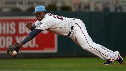 Minnesota Twins third baseman Miguel Sano dives for but misses a double hit by the Cleveland Indians' Jose Ramirez in the first inning of baseball game two of a doubleheader Saturday, June 17, 2017, in Minneapolis. (AP Photo/Bruce Kluckhohn)