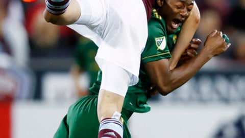 Colorado Rapids defender Kortne Ford, top, collides with Portland Timbers forward Fanendo Adi while pursuing the ball during the second half of an MLS soccer match Saturday, June 17, 2017, in Commerce City, Colo. The Rapids won 2-1. (AP Photo/David Zalubowski)