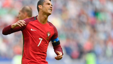 Portugal's Cristiano Ronaldo reacts during the Confederations Cup, Group A soccer match between Portugal and Mexico, at the Kazan Arena, Russia, Sunday, June 18, 2017. (AP Photo/Martin Meissner)
