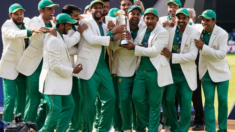 Pakistan players celebrate during the award ceremony for the ICC Champions Trophy at The Oval in London, Sunday, June 18, 2017. Pakistan won the final by crushing India for 180 runs. (AP Photo/Kirsty Wigglesworth)