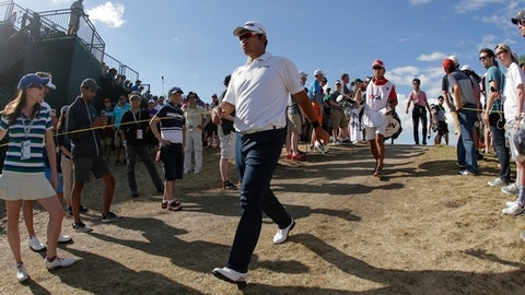 Hideki Matsuyama, of Japan, walks to the 16th hole during the fourth round of the U.S. Open golf tournament Sunday, June 18, 2017, at Erin Hills in Erin, Wis. (AP Photo/Charlie Riedel)