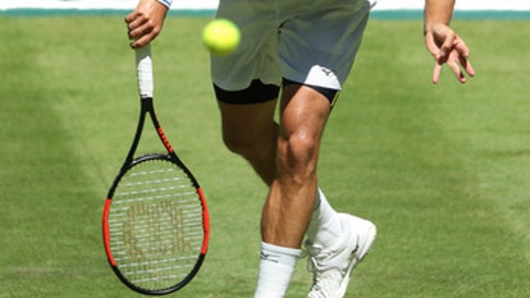 Philipp Kohlschreiber of Germany serves a ball during his match against Portugal's Joao Sousa during the ATP tennis tournament in Halle, Germany, Monday, June 19, 2017.  (Friso Gentsch/dpa via AP)