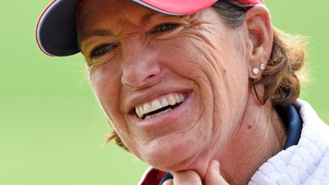 FILE - In this Sept. 18, 2015, file photo, Juli Inkster, team captain of the United States, smiles during the foursomes on Day 1 at the Solheim Cup golf tournament in St. Leon-Rot, southern Germany. The Des Moines Golf and Country Club held media day Monday, June 19, 2017, for the Solheim Cup, a three-day, biennial tournament between U.S. and European women's golfers. (AP Photo/Jens Meyer, File)