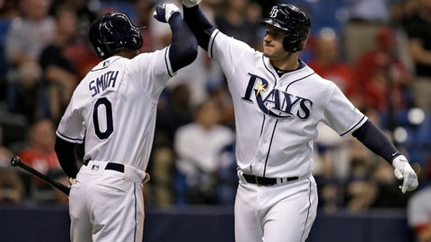 Tampa Bay Rays' Daniel Robertson, right, celebrates with on-deck batter Mallex Smith after Robertson hit a two-run home run off Cincinnati Reds relief pitcher Michael Lorenzen during the seventh inning of a baseball game Monday, June 19, 2017, in St. Petersburg, Fla. (AP Photo/Chris O'Meara)