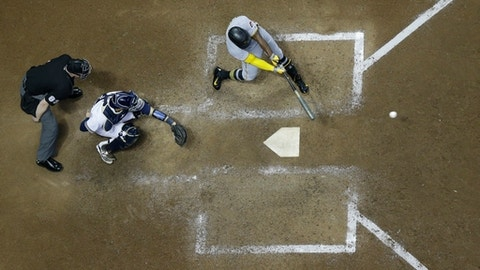 Pittsburgh Pirates' Andrew McCutchen hits an RBI single during the seventh inning of a baseball game against the Milwaukee Brewers Monday, June 19, 2017, in Milwaukee. (AP Photo/Morry Gash)