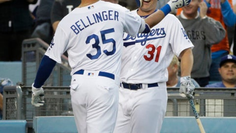 Los Angeles Dodgers' Cody Bellinger celebrates his home run with Joc Pederson during the second inning of a baseball game against the New York Mets Monday, June 19, 2017, in Los Angeles. (AP Photo/Jae C. Hong)