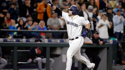 Seattle Mariners' Mike Zunino points toward the stands as he heads home on his two-run home run against the Detroit Tigers in the sixth inning of a baseball game Monday, June 19, 2017, in Seattle. (AP Photo/Elaine Thompson)