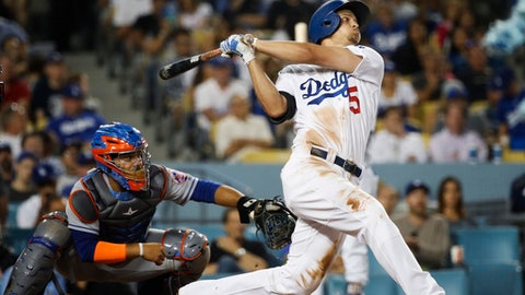 Los Angeles Dodgers' Corey Seager watches his third home run of the night, during the fifth inning of the team's baseball game against the New York Mets, Tuesday, June 20, 2017, in Los Angeles. (AP Photo/Jae C. Hong)