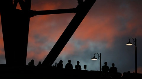 Fans watch from the 300 level after sunset, during the seventh inning of a baseball game between the Seattle Mariners and Detroit Tigers on Tuesday, June 20, 2017, in Seattle. (AP Photo/Lindsey Wasson)