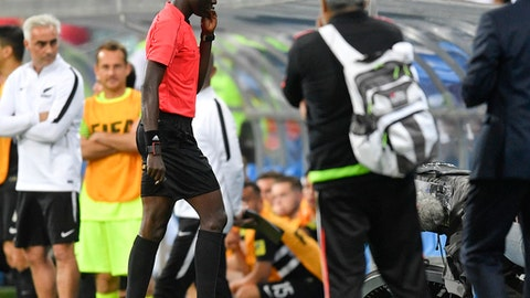 Gambian referee Bakary Gassama walks off the pitch after the Confederations Cup, Group A soccer match between Mexico and New Zealand, at the Fisht Stadium in Sochi, Russia, Wednesday, June 21, 2017. (AP Photo/Martin Meissner)