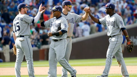 San Diego Padres from left, Cory Spangenberg (15), Erick Aybar, Wil Myers, and Jose Pirela celebrate the team's 3-2 win over the Chicago Cubs after a baseball game Wednesday, June 21, 2017, in Chicago. (AP Photo/Charles Rex Arbogast)