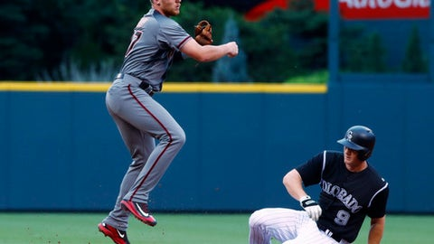 Arizona Diamondbacks second baseman Brandon Drury, left, forces out Colorado Rockies' DJ LeMahieu at second base on the front end of a double play hit into by Nolan Arenado to end the bottom of the first inning of a baseball game Wednesday, June 21, 2017, in Denver. (AP Photo/David Zalubowski)