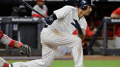 New York Yankees' Aaron Hicks follows through on an RBI single during the sixth inning of the team's baseball game against the Los Angeles Angels on Wednesday, June 21, 2017, in New York. (AP Photo/Frank Franklin II)