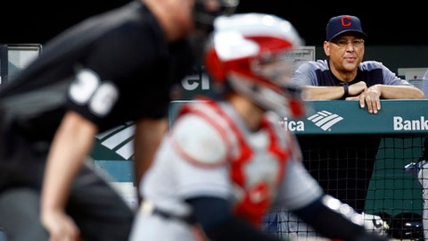 Cleveland Indians manager Terry Francona, right, watches during the second inning of the team's baseball game against the Baltimore Orioles in Baltimore on Wednesday, June 21, 2017. In the foreground are home plate umpire Ryan Blakney and Indians catcher Roberto Perez. (AP Photo/Patrick Semansky)