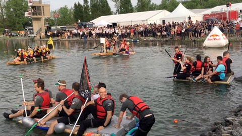 In this image from video, competitors take part in the raft race at the Formula 1 Canadian Grand Prix in Montreal on June 10, 2017. Just hours before strapping rock star drivers into multimillion-dollar cars traveling at more than 200 mph, team crews--and executives--traded their firesuits for life preservers in a beer-soaked beach party on the erstwhile Olympic rowing venue next to the Circuit Giles Villeneuve. (AP Photo/Jimmy Golen)