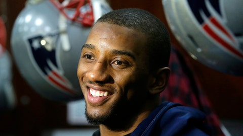 "FILE - In this Jan. 26, 2017 file photo, New England Patriots wide receiver Malcolm Mitchell speaks with members of the media in the team's locker room following an NFL football team practice in Foxborough, Mass. Mitchell has a three-book deal with Scholastic, the children's publisher said Thursday, June 23. The books include a newly illustrated edition of his self-published ""The Magician's Hat,"" to come out next May, and two more original works. (AP Photo/Steven Senne, File)"