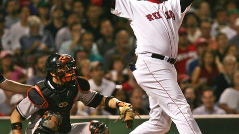 """FILE - In this Sept. 22, 2004, file photo, Boston Red Sox's David Ortiz watches the flight of his two run, home run off Baltimore Orioles starter Sidney Ponson, in the seventh inning at Fenway Park in Boston. The Red Sox prepare to honor Ortiz, retiring the No. 34 worn by """"Big Papi"""" when he led the once-cursed franchise to three World Series titles. The ceremony is Friday night, June 23, 2017.  (AP Photo/Charles Krupa, File)"""