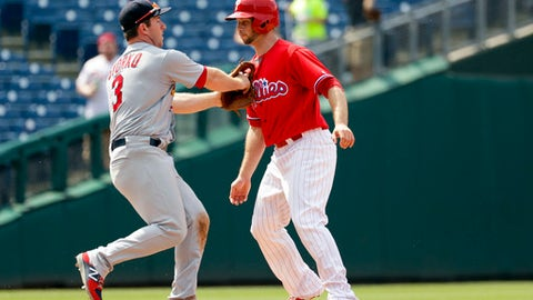 Philadelphia Phillies' Daniel Nava, right, is tagged out by St. Louis Cardinals third baseman Jedd Gyorko after being caught in a rundown on a two-run single by Tommy Joseph during the eighth inning of a baseball game, Thursday, June 22, 2017, in Philadelphia. Philadelphia won 5-1. (AP Photo/Matt Slocum)