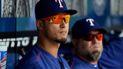 Texas Rangers' Yu Darvish, left, of Japan, and a member of the team's staff watch from the dugout during the sixth inning of a baseball game against the Toronto Blue Jays, Thursday, June 22, 2017, in Arlington, Texas. (AP Photo/Tony Gutierrez)