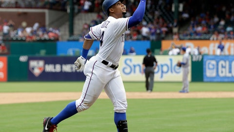 Texas Rangers' Carlos Gomez points skyward as he approaches the plate celebrating his two-run home run that came off a pitch from Toronto Blue Jays relief pitcher Cesar Valdez in the seventh inning of a baseball game, Thursday, June 22, 2017, in Arlington, Texas. The homer, Gomez' second of the game, scored Adrian Beltre. (AP Photo/Tony Gutierrez)