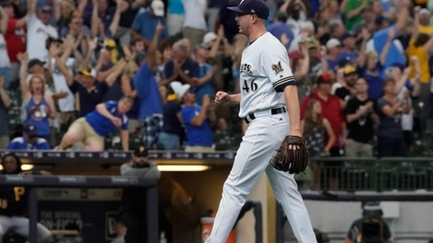 Milwaukee Brewers relief pitcher Corey Knebel reacts after the final out in the ninth inning of a baseball game against the Pittsburgh Pirates Thursday, June 22, 2017, in Milwaukee. Knebel broke an MLB record with the most consecutive games with a striukeout to being the season. The Brewers won 4-2. (AP Photo/Morry Gash)