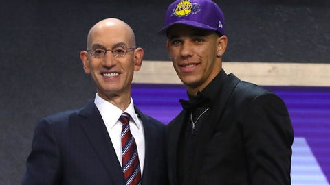 NEW YORK, NY - JUNE 22:  Lonzo Ball walks on stage with NBA commissioner Adam Silver after being drafted second overall by the Los Angeles Lakers during the first round of the 2017 NBA Draft at Barclays Center on June 22, 2017 in New York City. NOTE TO USER: User expressly acknowledges and agrees that, by downloading and or using this photograph, User is consenting to the terms and conditions of the Getty Images License Agreement.  (Photo by Mike Stobe/Getty Images)