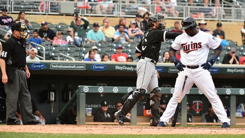 Minnesota Twins third baseman Miguel Sano reacts after being called out on strikes by umpire Jerry Meals during the fourth inning of a baseball game, Thursday, June 22, 2017, in Minneapolis. (AP Photo/John Autey)