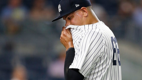 New York Yankees relief pitcher Dellin Betances wipes his face on his jersey while leaving the mound after allowing two runs during the seventh inning of the team's baseball game against the Los Angeles Angels in New York, Thursday, June 22, 2017. (AP Photo/Kathy Willens)
