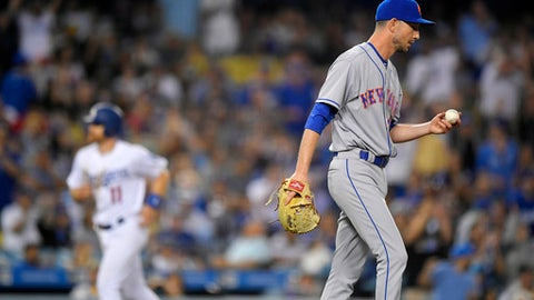 New York Mets relief pitcher Jerry Blevins, right, walks off the mound after issuing a bases-loaded walk, scoring Los Angeles Dodgers' Logan Forsythe, left, during the seventh inning of a baseball game, Thursday, June 22, 2017, in Los Angeles. (AP Photo/Mark J. Terrill)