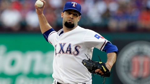 FILE - In this June 6, 2017, file photo, Texas Rangers starting pitcher Dillon Gee throws against the New York Mets in the first inning of an interleague baseball game, in Arlington, Texas. The Minnesota Twins have added two reinforcements for their depleted pitching staff, right-handers Dillon Gee and Trevor Hildenberger. (AP Photo/Tony Gutierrez, File)