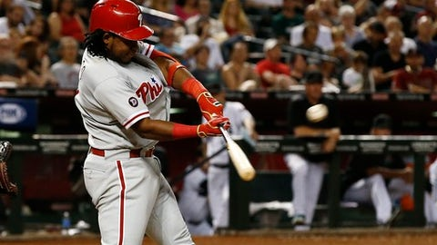Philadelphia Phillies' Maikel Franco connects for a home run against the Arizona Diamondbacks during the eighth inning of a baseball game Friday, June 23, 2017, in Phoenix. (AP Photo/Ross D. Franklin)