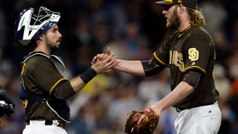 San Diego Padres catcher Austin Hedges, left, congratulates relief pitcher Brandon Maurer after the Padres defeated the Detroit Tigers 1-0 in a baseball game in San Diego, Friday, June 23, 2017. (AP Photo/Alex Gallardo)