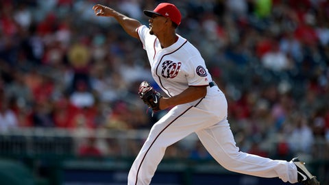 Washington Nationals' Joe Ross delivers a pitch during the third inning of a baseball game against the Cincinnati Reds, Saturday, June 24, 2017, in Washington. (AP Photo/Nick Wass)
