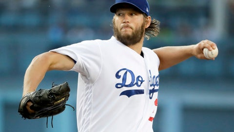 Los Angeles Dodgers starting pitcher Clayton Kershaw throws to the Colorado Rockies during the first inning of a baseball game in Los Angeles, Saturday, June 24, 2017. (AP Photo/Chris Carlson)