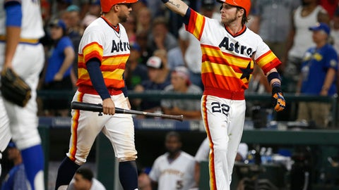 Houston Astros' Josh Reddick (22) motions to second after he and George Springer, left, scored on Brian McCann's three-RBI double against the Seattle Mariners during the seventh inning of a baseball game Saturday, June 24, 2017, in Seattle. (AP Photo/Jason Redmond)