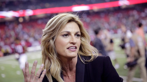 """FILE - In this Oct. 30, 2016 file photo, Fox Sports broadcaster Erin Andrews, left, speaks with Atlanta Falcons wide receiver Julio Jones after an NFL football game against the Green Bay Packers in Atlanta. Jennifer Allen, a publicist for Andrews, confirms Sunday, June 25, 2017, that the 38-year-old Fox Sports sideline reporter and """"Dancing with the Stars"""" co-host married the 35-year-old Stoll over the weekend.  (AP Photo/David Goldman, File)"""