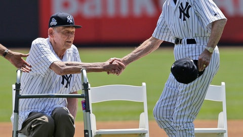 Former New York Yankees Bobby Brown, right, shakes hands with Don Larson during Old-Timers' Day at Yankee Stadium, Sunday, June 25, 2017, in New York. (AP Photo/Seth Wenig)