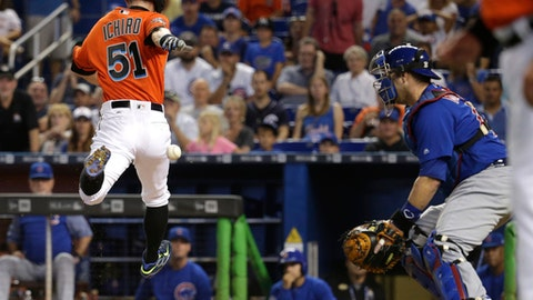 Miami Marlins' Ichiro Suzuki (51) beats the throw to Chicago Cubs catcher Miguel Montero to score on a single hit by Marcell Ozuna during the first inning of a baseball game, Sunday, June 25, 2017, in Miami. (AP Photo/Lynne Sladky)