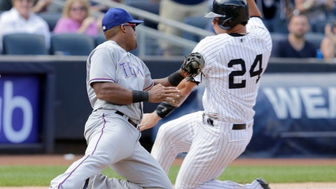 Texas Rangers third baseman Adrian Beltre, left, tags New York Yankees' Gary Sanchez as he tries to slide into third base during the seventh inning of the baseball game at Yankee Stadium Sunday, June 25, 2017 in New York. (AP Photo/Seth Wenig)