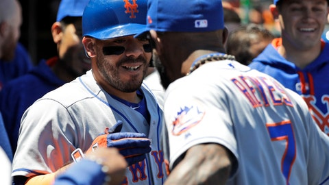 New York Mets' Rene Rivera, left, celebrates his solo home run with teammate Jose Reyes, right, during the fourth inning of a baseball game against the San Francisco Giants, Sunday, June 25, 2017, in San Francisco. (AP Photo/Marcio Jose Sanchez)