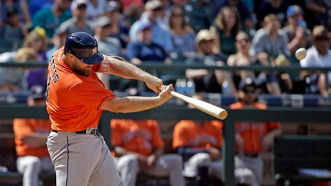 Houston Astros' Evan Gattis belts a two-run home run against the Seattle Mariners in the ninth inning of a baseball game Sunday, June 25, 2017, in Seattle. (AP Photo/Elaine Thompson)