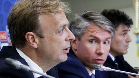 From Left: Colin Smith, FIFA chief competitions and events officer, Alexey Sorokin, 2018 FIFA World Cup Russia local organising committee CEO, and Massimo Busacca, FIFA head of refereeing, attend half–time press conference following the group stage of the Confederations Cup in St.Petersburg, Russia, Monday, June 26, 2017. (AP Photo/Dmitri Lovetsky)