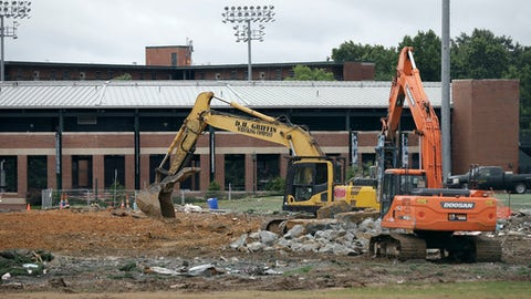 This photo taken Wednesday, June 21, 2017, shows renovation at the football practice facility at the University of North Carolina in Chapel Hill, N.C. North Carolina athletic director Bubba Cunningham has talked for years about the need to build an indoor football practice facility among a series of facility upgrades. That work _ part of a $100 million project _ is underway to close a 2016-17 sports season that saw UNC win a men's basketball national championship and continue to deal with its multi-year NCAA academic scandal. (AP Photo/Gerry Broome)