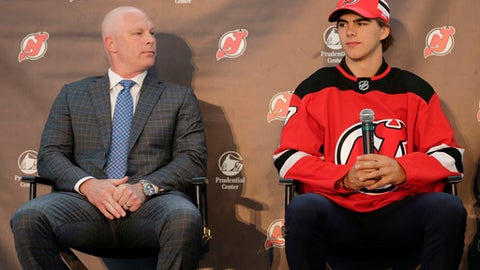 New Jersey Devils' Nico Hischier, right, and head coach John Hynes participate in a news conference in Newark, N.J., Monday, June 26, 2017. The 18-year-old center was the first Swiss-born player to be drafted first overall in the NHL draft. (AP Photo/Seth Wenig)