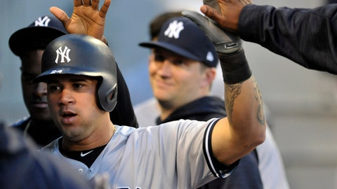 New York Yankees' Gary Sanchez celebrates with teammates in the dugout after scoring on a Chase Headley single during the fourth inning of a baseball game against the Chicago White Sox, Monday, June 26, 2017, in Chicago. (AP Photo/Paul Beaty)