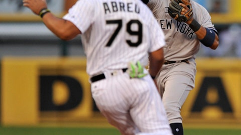 New York Yankees second baseman Starlin Castro throws to first base after forcing out Chicago White Sox's Jose Abreu at second base during the fourth inning of a baseball game, Monday, June 26, 2017, in Chicago. (AP Photo/Paul Beaty)