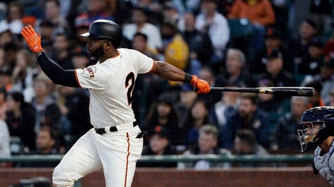 San Francisco Giants' Denard Span follows through on an RBI-triple against the Colorado Rockies during the fourth inning of a baseball game Monday, June 26, 2017, in San Francisco. (AP Photo/Marcio Jose Sanchez)