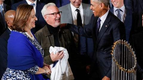 FILE - This Jan. 16, 2017 file photo shows then-President Barack Obama talking with Cubs manager Joe Maddon, center, and co-owner Laura Ricketts, left, during a ceremony in the East Room of the White House in Washington, where the president honored the 2016 World Series Champion baseball team. Maddon and some members of the Chicago Cubs will visit the White House on Wednesday, June 28, 2017 though it's not an official visit with President Donald Trump. (AP Photo/Pablo Martinez Monsivais)