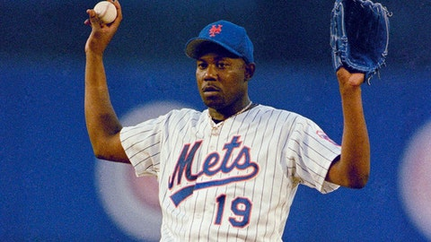 FILE - In this June 22, 1993, file photo, New York Mets pitcher Anthony Young calls for a a new ball during the team's baseball game against the Montreal Expos in New York. Young, who set a major league record with 27 straight losses, has died. He was 51. The Mets said Young died Tuesday, June 27, 2017, in Houston after a long illness. He had told former teammates this spring that he had a brain tumor. (AP Photo/Ron Frehm, File)
